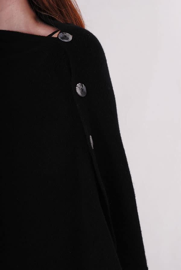 Pink and ginger 100% cashmere black poncho buttons close up